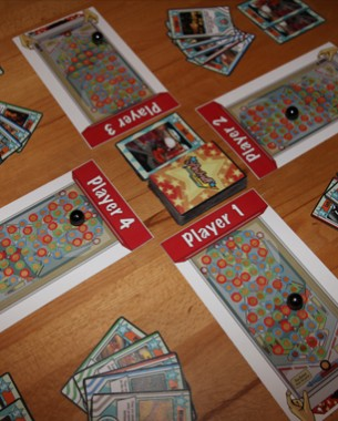 Ever wondered how pinball played in the form of a card game? Pinball The Card Game is a strategy card game where four players play against each other to become the ultimate pinball master. Players use cards to earn points and control the ball on the playfield. They only have two balls and when they lose both, it's game over! You can win in two different ways: Be the first to earn 40 points or be the last who's not game over.